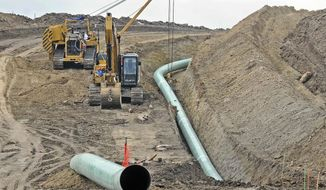 In this Oct. 5, 2016, file photo, heavy equipment is seen at a site where sections of the Dakota Access pipeline were being buried near the town of St. Anthony in Morton County, N.D.  (Tom Stromme/The Bismarck Tribune via AP)  **FILE**