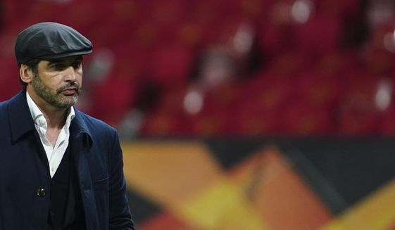 Roma's head coach Paulo Fonseca leaves the pitch at the end of the Europa League semi final, first leg soccer match between Manchester United and Roma at Old Trafford in Manchester, England, Thursday, April 29, 2021. (AP Photo/Jon Super)