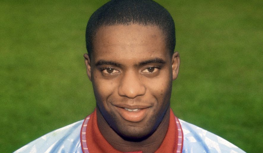 FILE - This July 1, 1991 file photo shows Dalian Atkinson of Aston Villa. British prosecutors accused police officer Benjamin Monk on Tuesday May 4, 2021,of using unnecessary force against Dalian Atkinson, 48, a former Premier League soccer player, who died after being kicked in the head and shot with a stun gun. Police Constable Mary Ellen Bettley-Smith, 31, is also facing trial charged with assault. (PA via AP, File)