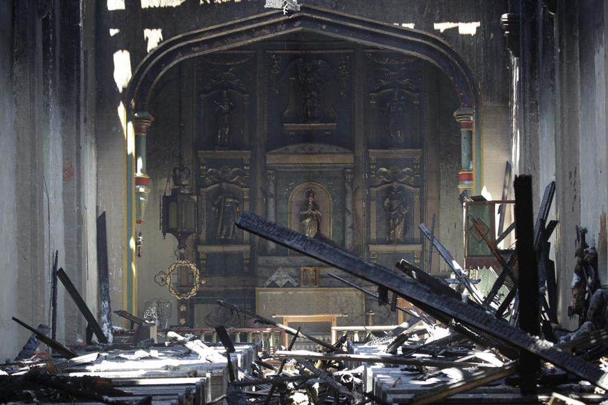 In this Saturday, July 11, 2020, file photo, the interior of the San Gabriel Mission is seen in the aftermath of an early morning fire in San Gabriel, Calif.  A fire that gutted much of the historic Catholic church in Southern California last year was intentionally set by a 57-year-old man, prosecutors said Tuesday, May 4, 2021. John David Corey faces multiple felony counts including arson of an inhabited structure, the Los Angeles County District Attorney's Office said in a statement  (AP Photo/Marcio Jose Sanchez, File)