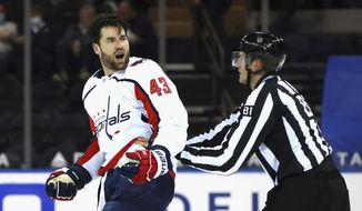 Washington Capitals' Tom Wilson (43) yells at the New York Rangers bench after taking a second-period penalty during an NHL hockey game Monday, May 3, 2021, in New York. (Bruce Bennett/Pool Photo via AP) **FILE**