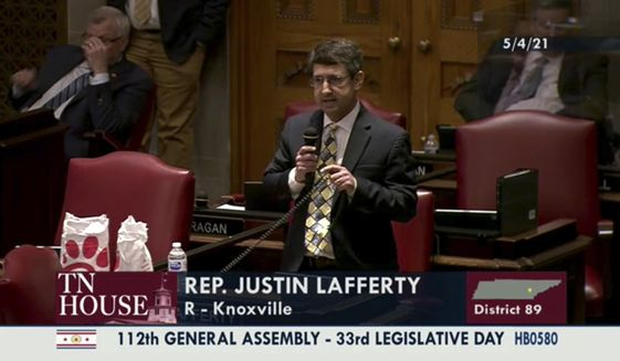 """In this still image from video provided by the Tennessee General Assembly, Rep. Justin Lafferty, R-Knoxville, speaks on the floor of the House of Representatives at the State Capitol in Nashville, Tenn., on Tuesday, May 4, 2021. Lafferty falsely declared that an 18th century policy designating a slave as three-fifths of a person was adopted for """"the purpose of ending slavery,"""" commenting amid a debate over whether educators should be restricted while teaching about systematic racism in America. (Tennessee General Assembly via AP)"""