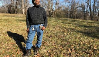 FILE - In this Jan. 28, 2021, file photo, Clyde Robinson, 80, speaks with a reporter while standing on his acre-sized parcel of land, in Memphis, Tenn.  Robinson has been fighting an effort by two companies seeking a piece of his land to build part of an oil pipeline that would run through the Memphis area into north Mississippi. City council members in Memphis, Tenn., delayed a vote Tuesday, May 4, on a law that could make it more difficult for a company to build an oil pipeline over an aquifer that provides clean drinking water to 1 million people. The pipeline company also agreed to halt eminent domain lawsuits against property owners like Robinson  (AP Photo/Adrian Sainz, File)