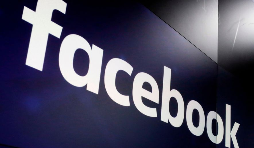 In this March 29, 2018, file photo, the logo for Facebook appears on screens at the Nasdaq MarketSite in New York's Times Square. Former President Trump will find out whether he gets to return to Facebook on Wednesday, May 5, 2021, when the social network's quasi-independent Oversight Board plans to announce its ruling in the case involving the former president.  (AP Photo/Richard Drew, File)