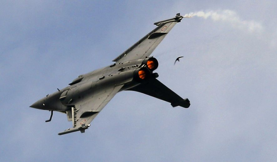 FILE- In this Tuesday, June 18, 2019, file photo, a Dassault Rafale fighter jet performs its demonstration flight at Paris Air Show, in Le Bourget, north east of Paris, France. Egypt is buying another 30 Rafale fighter jets from France, building up its fleet of the advanced warplane to 54, second only to the French Air Force. Both countries confirmed the deal separately on Tuesday. The Egyptian military said the purchase would be financed with a 10-year French loan. The value of the deal wasn't given. (AP Photo/ Francois Mori, File)