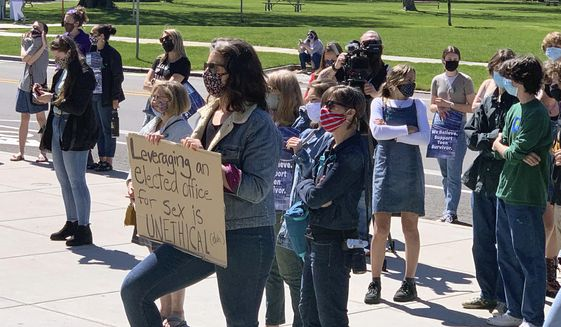 Supporters of a 19-year-old legislative intern who reported she was raped by a lawmaker nearly two decades her senior gathered for a rally outside the Idaho Statehouse on Wednesday, April 28, 2021. Inside, a legislative ethics committee was holding a public hearing to determine if state Rep. Aaron von Ehlinger, a Republican from Lewiston, should face censure or expulsion for the alleged conduct. (AP Photo/Rebecca Boone)