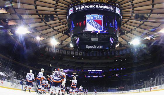 The New York Islanders celebrate a shutout against the New York Rangers in an NHL hockey game Thursday, April 29, 2021, in New York. (Bruce Bennett/Pool Photo via AP)