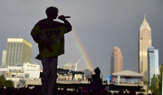 Machine Gun Kelly performs at the NFL Draft Theatre at the NFL football draft Saturday, May 1, 2021, in Cleveland. (AP Photo/David Dermer)