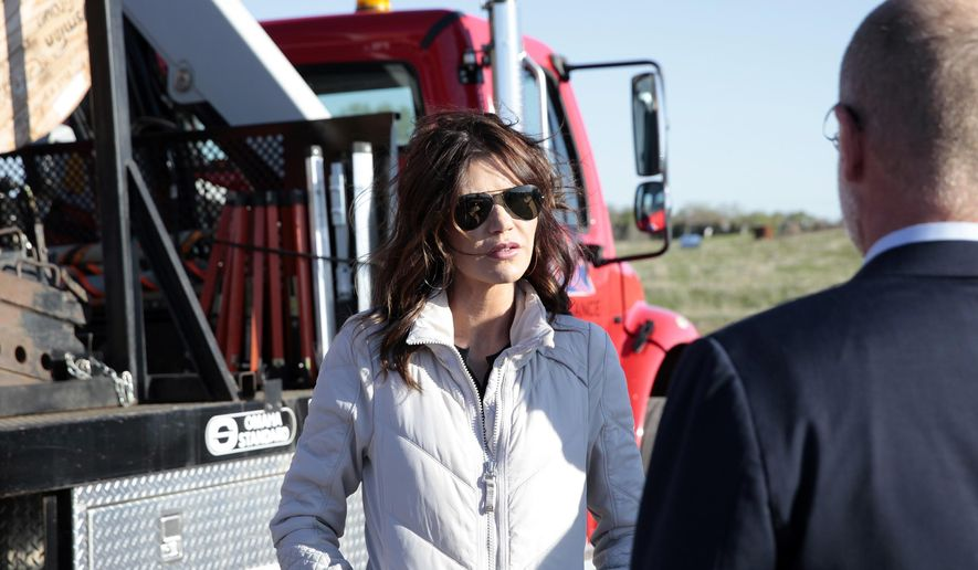 South Dakota Gov. Kristi Noem speaks with FCC Commissioner Brendan Carr, right, on Tuesday, May 4, 2021, during a tour of a site where broadband internet fiber was recently installed near Brandon, S.D. (AP Photo/Stephen Groves)