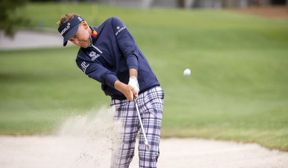 Ian Poulter, of England, hits out of the bunker on the 15th fairway during the second round of the RBC Heritage golf tournament in Hilton Head Island, S.C., Friday, April 16, 2021. (AP Photo/Stephen B. Morton)