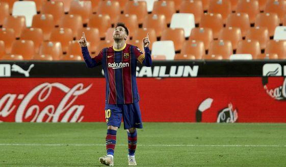 Barcelona's Lionel Messi celebrates scoring his side's 3rd goal during the Spanish La Liga soccer match between Valencia and Barcelona at the Mestalla stadium in Valencia, Spain, Sunday, May 2, 2021. (AP Photo/Alberto Saiz)