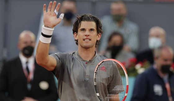 Dominic Thiem of Austria celebrates after defeating Marcos Giron of the U.S. 6-1, 6-3 during their match at the Madrid Open tennis tournament in Madrid, Spain, Tuesday, May 4, 2021. (AP Photo/Paul White)