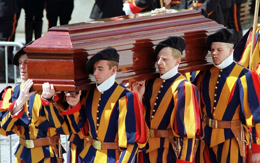 """FILE - In this  Saturday May 16, 1998 filer,  members of the papal Swiss Guard carry the coffin of Alois Estermann, newly appointed commander of the Swiss papal guards at the Vatican, out of the St. Stephan's church in Beromuenster, Switzerland. The Vatican secretary of state has intervened personally in one of the most sensational Vatican scandals of recent times: The 1998 murder of the Swiss Guard commander and his wife, purportedly by a disgruntled younger Swiss Guardsman who then took his own life. Cardinal Pietro Parolin asked the Vatican City State tribunal to pay """"particular attention"""" to the request by the mother of the accused guardsman, Cedric Tornay, to have access to the court files of the investigation that was officially archived in 1999. (AP Photo/TEAM, File )"""