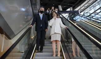 U.S. Sen. Jacky Rosen, D-Nev., right, tours T-Mobile Arena with John Flynn, left, vice president of administration at MGM Resorts International, Tuesday, May 4, 2021, in Las Vegas. (AP Photo/John Locher)