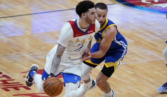 New Orleans Pelicans guard Lonzo Ball (2) drives past Golden State Warriors guard Stephen Curry in the second half of an NBA basketball game in New Orleans, Tuesday, May 4, 2021. The Pelicans won 108-103. (AP Photo/Gerald Herbert)