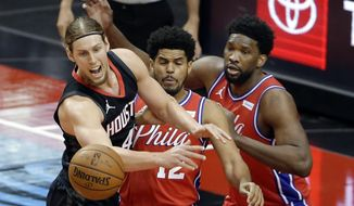 Houston Rockets forward Kelly Olynyk, left, loses the ball in front of Philadelphia 76ers forward Tobias Harris (12) and center Joel Embiid, right, during the first half of an NBA basketball game Wednesday, May 5, 2021, in Houston. (AP Photo/Michael Wyke, Pool)