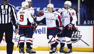 Washington Capitals' T.J. Oshie, center, celebrates his second goal of the night against the New York Rangers, during the second period of an NHL hockey game Wednesday, May 5, 2021, in New York. (Bruce Bennett/Pool Photo via AP)