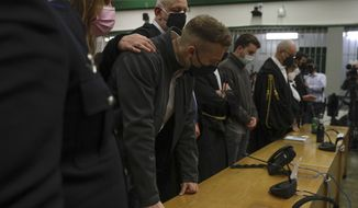 Finnegan Lee Elder, foreground, listens as the verdict is read, in the trial for the slaying of an Italian plainclothes police officer on a street near the hotel where he and his co-defendant Gabriel Natale-Hjorth were staying while on vacation in Rome in summer 2019, in Rome, Wednesday, May 5, 2021. (AP Photo/Gregorio Borgia)