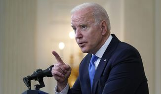 President Joe Biden gesturing as he takes questions from reporters as he speaks about the American Rescue Plan, in the State Dining Room of the White House, Wednesday, May 5, 2021, in Washington. (AP Photo/Evan Vucci) **FILE**