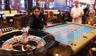 "In this June 20, 2019 photo, a game of roulette is underway at the Hard Rock casino in Atlantic City, N.J. A report released Wednesday, May 5, 2021, from a state panel recommended rebuilding Atlantic City's Boardwalk, improving the look of its business districts, and embracing the ""blue economy"" of the ocean to help the seaside gambling resort recover from the COVID-19 pandemic. It also suggested money from legalized marijuana sales could help pay for it.  (AP Photo/Wayne Parry)"