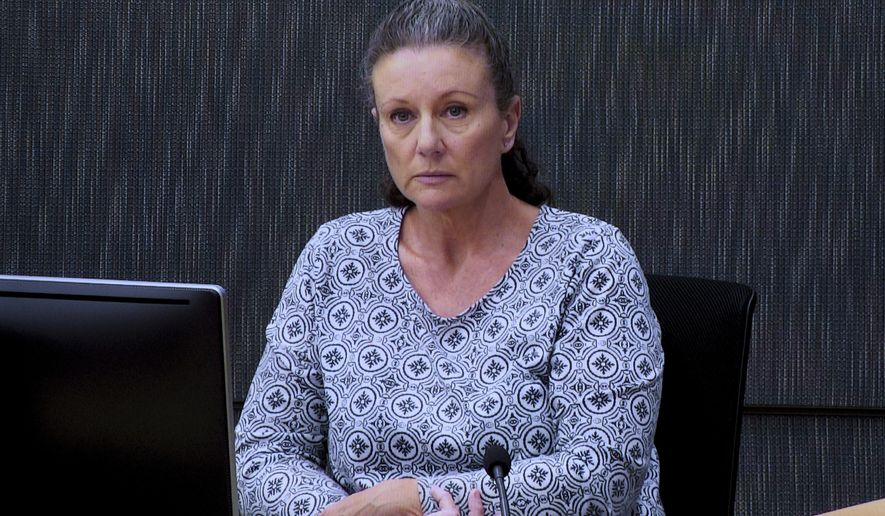 Kathleen Folbigg appears via video link during a convictions inquiry at the NSW Coroners Court in Sydney, Australia on May 1, 2019. Nearly two decades after Folbigg was convicted of killing her four children, dozens of scientists are backing the claim that they may have died of natural causes. (Joel Carrett/AAP Image via AP)