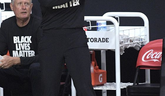 FILE - Atlanta Dream head coach Nicki Collen calls out instructions during the first half of a WNBA basketball game against the Dallas Wings in Bradenton, Fla., in this Sunday, July 26, 2020, file photo. Collen was preparing for a fourth season as head coach of the WNBA's Atlanta Dream, even leading them through practice Monday, May 3, 2021, before being named that night the new coach for the Lady Bears' program that Kim Mulkey built into a national power the past 21 years. Collen is expected to be formally introduced as the coach at Baylor Wednesday, May 5. (AP Photo/Phelan M. Ebenhack, File)