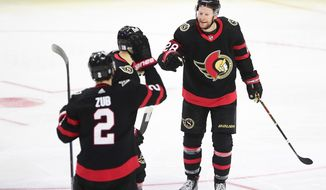 Ottawa Senators' Connor Brown, right, celebrates a goal with teammates against the Montreal Canadiens during the third period of an NHL hockey game, Wednesday, May 5, 2021 in Ottawa, Ontario. (Sean Kilpatrick/The Canadian Press via AP)