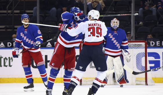 New York Rangers' Pavel Buchnevich (89) hits Washington Capitals' Anthony Mantha (39) with his stick during the second period of an NHL hockey game Wednesday, May 5, 2021, in New York. Buchnevich was penalized for high-sticking. (Bruce Bennett/Pool Photo via AP) **FILE**