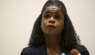 FILE - In this Aug. 10, 2020 file photo, Cook County State's Attorney Kim Foxx speaks during a news conference in Chicago. Foxx apologized Wednesday, May 5, 2021, for a suggestion by one of her attorneys that 13-year-old Adam Toledo was holding a gun the instant he was fatally shot by a Chicago police officer in March. She also acknowledged that neither she nor anyone in her office tried to clear up the matter until right before video was released showing that wasn't actually the case.  (Ashlee Rezin Garcia/Chicago Sun-Times via AP, File)