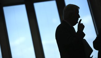FILE - In this Wednesday, Sept. 4, 2019 file photo, European Union chief Brexit negotiator Michel Barnier is seen in profile as he attends a weekly meeting of the College of Commissioners at EU headquarters in Brussels. He's known throughout most of Europe as Mr. Brexit, but not so well known at home in France. With a new book out this week, and interviews in national media, Michel Barnier is trying to raise his profile ahead of next April's presidential election. (AP Photo/Francisco Seco, File)