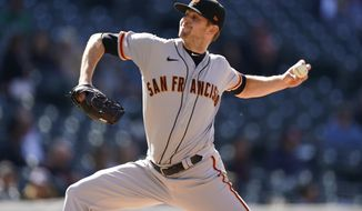 San Francisco Giants relief pitcher Sam Selman works against the Colorado Rockies during the fifth inning of a baseball game Wednesday, May 5, 2021, in Denver. (AP Photo/David Zalubowski)