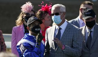John Velazquez, left, talks with Todd Pletcher after Velazquez rode Malathaat to victory during the 147th running of the Kentucky Oaks at Churchill Downs, Friday, April 30, 2021, in Louisville, Ky. (AP Photo/Jeff Roberson)