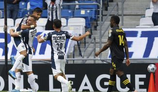 Maximiliano Meza of Mexico's Monterrey, left, is congratulated by his teammates after scoring his team's second goal against Unites States' Columbus Crew in a Concacaf Champions League soccer game in Monterrey, Mexico, Wednesday, May 5, 2021. (AP Photo/Roberto Martinez)