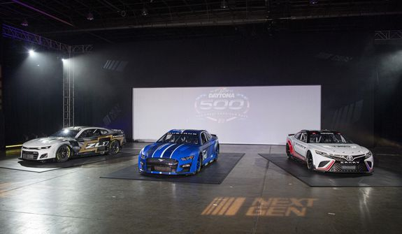 NASCAR unveils the Next Gen Cup cars for the 2022 season during the NASCAR media event in Charlotte, N.C., Wednesday, May 5, 2021. (AP Photo/Mike McCarn)