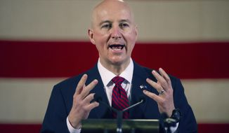 """FILE - In this Feb. 26, 2021, file photo, Nebraska Governor Pete Ricketts speaks during a news conference at the Nebraska State Capitol in Lincoln, Neb. Ricketts is ramping up his crusade for the meat industry Wednesday, April 5, 2021, by endorsing a new """"beef passport"""" program to promote meat eating, a few weeks after he blasted Colorado's governor for a resolution encouraging its residents to eat less. (Kenneth Ferriera/Lincoln Journal Star via AP, File)"""