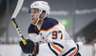 Edmonton Oilers' Connor McDavid skates against the Vancouver Canucks during the first period of an NHL hockey game, Monday, May 3, 2021, in Vancouver, British Columbia. (Darryl Dyck/The Canadian Press via AP)