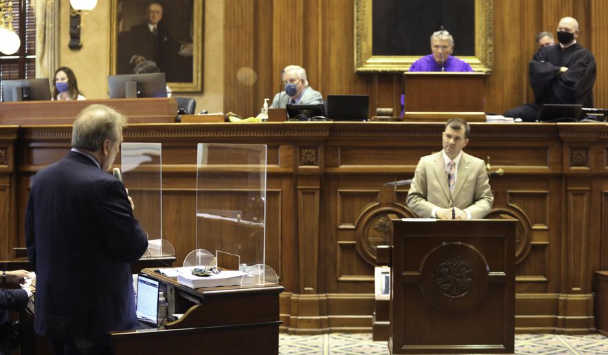 South Carolina Senate Minority Leader Brad Hutto, left, D-Orangeburg, asks a question of Sen. Tom Young, right, R-Aiken, during a debate on a bill that would allow people with a concealed weapons permit in the state carry their guns in the open on Tuesday, May 4, 2021, in Columbia, S.C. The bill was placed on a special place on the calendar for debate. (AP Photo/Jeffrey Collins)