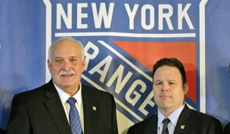 John Davidson, left, president of the New York Rangers, and Rangers general manager Jeff Gorton pose at a news conference in New York, in this Wednesday, May 22, 2019, file photo. The New York Rangers fired president John Davidson and general manager Jeff Gorton on Wednesday, May 5, 2021 according to multiple published reports. The New York Post and Sportsnet reported Davidson and Gorton had been fired with three games left in the season and replaced by associate general manager and former Rangers captain Chris Drury.(AP Photo/Seth Wenig, File). **FILE**