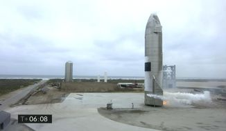 In this image from video made available by SpaceX, a Starship test vehicle sits on the ground after returning from a flight test in Boca Chica, Texas on Wednesday, May 5, 2021. (SpaceX via AP)