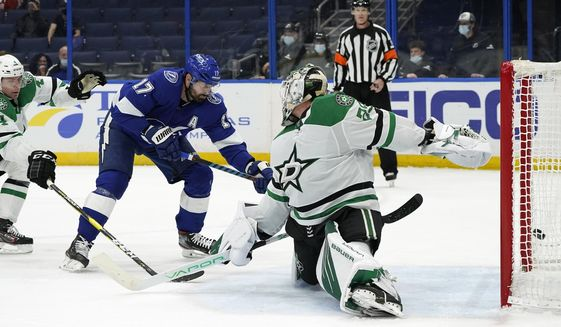 Tampa Bay Lightning left wing Alex Killorn (17) shoots past Dallas Stars goaltender Jake Oettinger (29) for a goal during the second period of an NHL hockey game Wednesday, May 5, 2021, in Tampa, Fla. (AP Photo/Chris O'Meara)