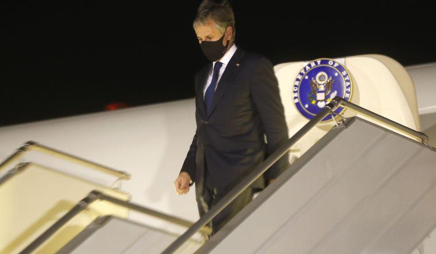 U.S. Secretary of State Antony Blinken disembarks after landing at Boryspil International airport outside Kyiv, Ukraine, early Thursday, May 6, 2021. (AP Photo/Efrem Lukatsky, Pool)