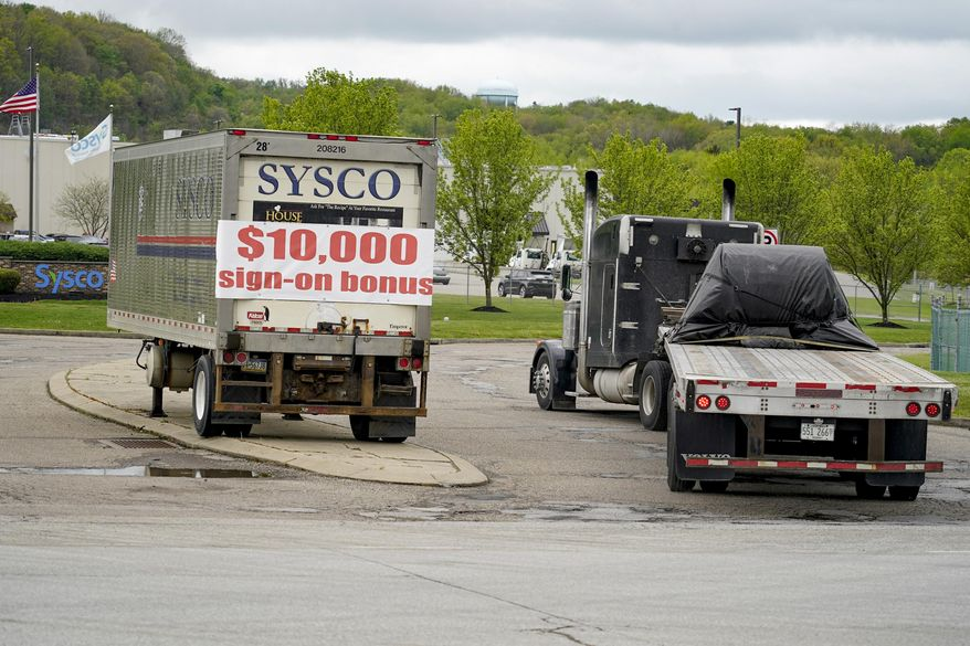 A tractor trailer rig pulls into a terminal for a trucking company that has a $10,000 hiring bonus offer posted on a trailer at their facility in Harmony, Pa., Wednesday, May 5, 2021. A bill by Pennsylvania's Republican-controlled Legislature to reinstate work-search requirements for people claiming unemployment benefits cleared the House Labor and Industry Committee on a party-line vote Tuesday. The sponsor, Rep. Jim Cox of Berks County, said many employers are having trouble finding workers. (AP Photo/Keith Srakocic) ** FILE **