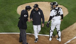 FILE - In this April 12, 2021, file photo, Chicago White Sox manager Tony La Russa, center, argues with home plate umpire Gabe Morales (47) while catcher Yasmani Grandal (24) listens during the ninth inning of the team's baseball against the Cleveland Indians in Chicago. La Russa developed a reputation as a master strategist while managing the Oakland Athletics to a World Series championship and the St. Louis Cardinals to two more. His second tenure with the Chicago White Sox is off to a bumpy start. (AP Photo/Paul Beaty, File)