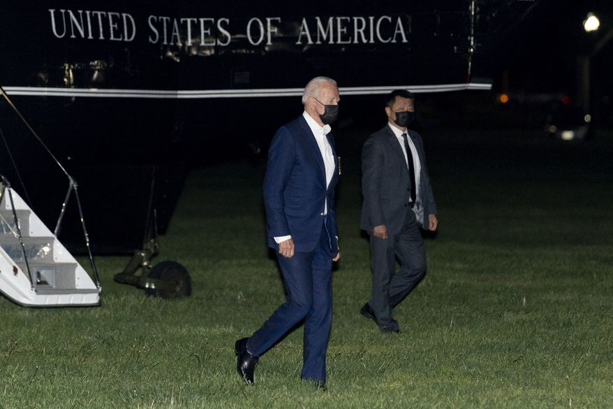 President Joe Biden arrives on the Ellipse at the White House in Washington, Thursday, May 6, 2021, after a short trip from Andrews Air Force Base, Md., as Biden returns from Louisiana. (AP Photo/Andrew Harnik)