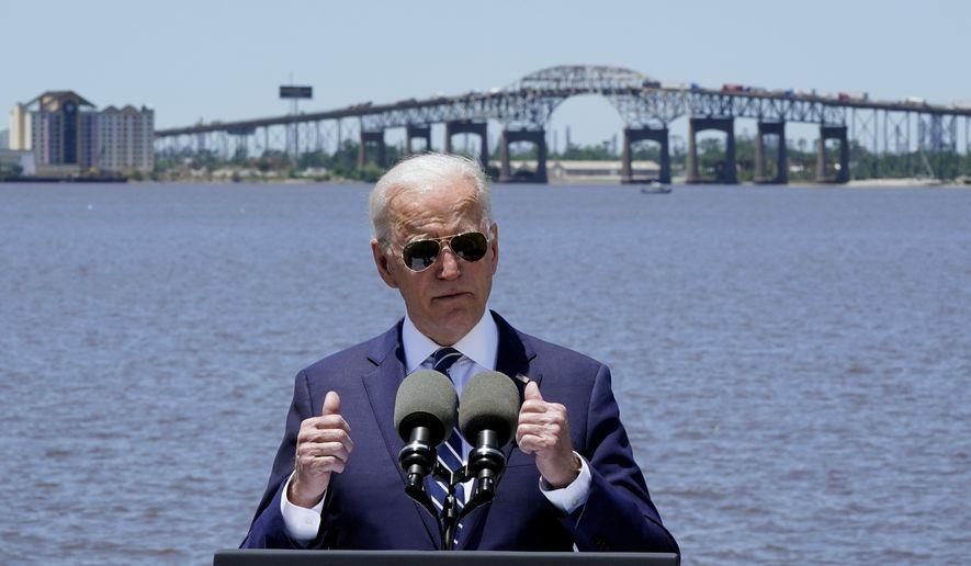 President Joe Biden speaks with the Interstate 10 Calcasieu River Bridge behind him, Thursday, May 6, 2021, in Lake Charles, La. (AP Photo/Alex Brandon)