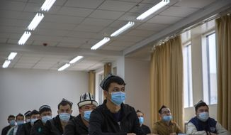 Uyghurs and other students listen to an instructor during a class at the Xinjiang Islamic Institute, as seen during a government organized visit for foreign journalists, in Urumqi in western China's Xinjiang Uyghur Autonomous Region on April 22, 2021. (AP Photo/Mark Schiefelbein)  **FILE**