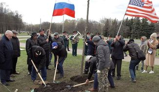 "Russians and Americans plant ""Friendship"" tree in the ""Victory Park"" on Poklonnaya Gora in Moscow on April 25, 2021."
