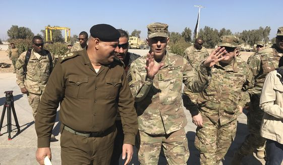 In this Feb. 8, 2017, file photo, then-Army Lt. Gen. Stephen Townsend talks with an Iraqi officer during a tour north of Baghdad, Iraq. Townsend, now a general, says a growing military threat from China may well come from Americas east, as Beijing looks to establish a large navy port capable of hosting submarines or aircraft carriers on the Atlantic coast of Africa.(AP Photo/ Ali Abdul Hassan, File)