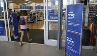 A sign looking to hire employees is displayed at the entrance to a Bed, Bath and Beyond store, Tuesday, May 4, 2021, in Miami. (AP Photo/Marta Lavandier) ** FILE **