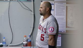 Los Angeles Angels Albert Pujols leans on his bat in the dugout during the eighth inning of a baseball game against the Seattle Mariners, Sunday, May 2, 2021, in Seattle.  (AP Photo/Ted S. Warren) **FILE**